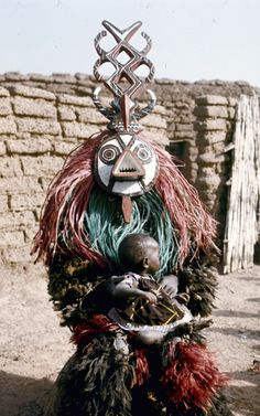Africa | Nunuma or Winiama masquerader, resting with a child on their lap. Burkina Faso. ca. 1970/1 | Photographer unknown