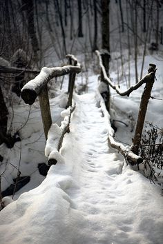 Fairytale bridge with crooks and bends ... #snowy woods #wooden walking bridge