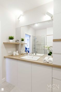 So many options for mixing bamboo countertop, sides, kickplate, and shelves. How to decide! Condo Bathroom, Narrow Bathroom, Laundry In Bathroom, Bathroom Layout, Modern Bathroom Design, Bathroom Interior Design, Bathroom Furniture, Haacke Haus, Bathroom With Shower And Bath