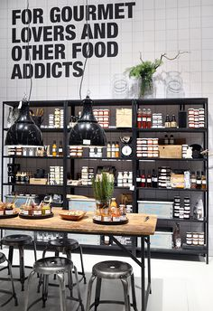 Anything with the phrase Food Addicts on the wall is bound to be a keeper. A clinical look that is made warm with timber tones and fresh greenery.