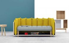 This sofa is like a floating island surrounded by removable cushions