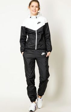 This girl's got an Awesome!! nylon Nike tracksuit... style!!
