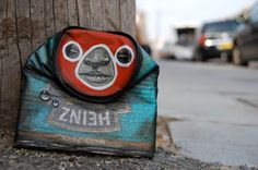 Can Man    Street artist My Dog Sighs paints faces on found cans and leaves the artworks on the street for people to find. The artist combines street art with the idea of art being for everyone.