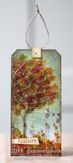 Blip distress stains for foliage. Stamp tree on acetate w/Stazon, then emboss acetate and overlay on tag