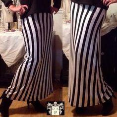 I just added this to my closet on Poshmark: NWT bold black & white stripe maxi skirt. Price: $28 Size: L