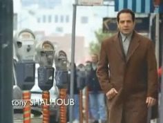 Tony Shaloub in a knee length brown suede jacket. From the opening credits of Monk