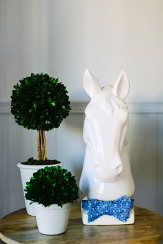 Kentucky Derby Party Guide: For fun, dress up your home decor with bow ties and horse motifs — even plastic toy horses look chic with a coat of spray-paint.