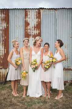 mixed and matched bridesmaid perfection! [Rustic Farm Wedding by Coralee]