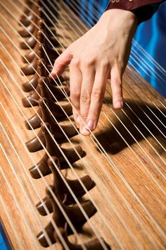 The gayageum is a traditional Korean instrument. It has 12 silk strings, 12 movable bridges, and a convex upper surface. The sound is produced by plucking the stings on the right side of the bridges, and the different pitches (and vibrato) comes from the manipulation of the strings on the left side of the bridges.