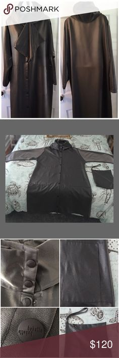 """Babette Long Hooded Raincoat with zipper bag. This is an awesome raincoat! Great used condition(inside has some wear). The color is a gun metal gray & snaps up the front. The pockets are large & roomy. Very Stylish! The inside tag is quite worn, but it is considered a medium. I would say up to a size 14 could wear this comfortably. Measurements are:27.5"""" (a2a); 45.5"""" (L); 23"""" (L) outside top of sleeve; 17.5"""" (L) inside bottom of sleeve; Bottom of coat 30""""wide; Top of shoulders 20.5"""" Babette…"""