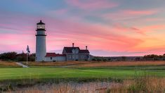 Golf with a view at Highland Links in North Truro Cape Cod MA. The historic Highland Light, also known as Cape Cod Light, and off in the distance is the Pilgrim monument in Provincetown.
