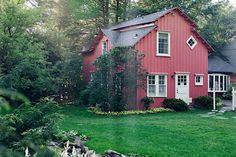 Red siding, white trim, medium gray roof...