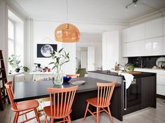 Kitchen with colourful chairs
