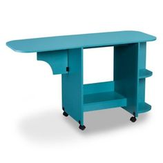 Make a bold, creative statement in any room with the Southern Enterprises Expandable Rolling Sewing Table/Craft Station. Stylish and functional, the table expands, folds to fit into small spaces, and features side shelves to house all your supplies. Sewing Machine Tables, Sewing Tables, Turquoise Bedding, Craft Station, Sewing Station, Sewing Room Organization, Studio Organization, Welding Table, Find Furniture