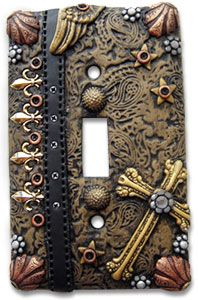 Maire Segal's switchplate made of polymer clay.  Yeah!  no more boring white or cream plastic switch plates