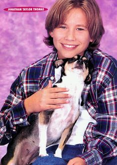 Um, OK, another puppy. | 23 Photos Of Jonathan Taylor Thomas Holding Things