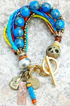 Olympian charm bracelet. blue, orange and yellow