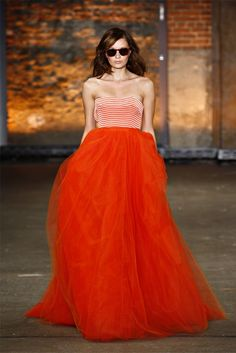 I think this might convince me to get on board with orangey colored clothes. Love how the skirt moves too.