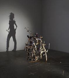 New Shadow Sculptures Built from Discarded Wood from Tim Noble and Sue Webster    Titled Nihilistic Optimistic, the exhibition includes six large-scale sculptures built from what appear to be haphazard clumps of discarded wood but when illuminated by a light projector create uncannily accurate self-portraits of the artists