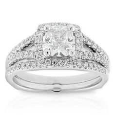 Ikuma Canadian diamond two-piece wedding set with a 1 carat cushion cut diamond. Other non-Ikuma diamonds total an additional 1/2 carat weight. This bridal set is in 14K white gold. <b>All Ikuma diamonds originate from North America and are mined in Canada.</b> American Gem Society (AGS) documentation provided on center Ikuma diamond.