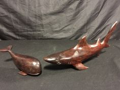 PAIR OF CARVED HARDWOOD ANIMAL FIGURES INCLUDING A 16 INCH GREAT WHITE SHARK AND AN 8 INCH WHALE