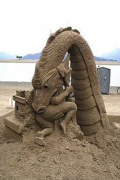 Sand art dragon eating sculptor