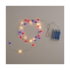 Cost Plus World Market Star Micro LED Battery Operated 30 Bulb String... ($13) ❤ liked on Polyvore featuring home, lighting, red lights, red lamp, battery powered lamp, battery lights and red white and blue lights