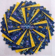 Quilting Fabric Blue and Yellow Floral Swirl Charm pack 5 inch squares 40 pk.