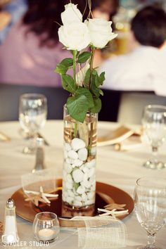 I gathered White Rocks off the beach for a year and used them in our centerpieces.