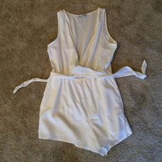 White romper Showpo (Australian boutique). Worn once on my honeymoon! Cross ties, can adjust exposure. Adorable and perfect for bridal showers, engagement parties, honeymoon!! Size 10 in Australia = size 4-6 in US Pants Jumpsuits & Rompers