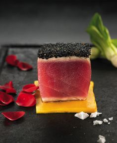 Seared tuna with mango topped with caviar.