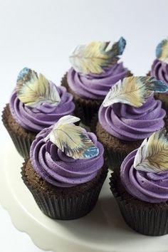 Hand painted feather cupcakes from julietstallwoodcakesandbiscuits.co.uk