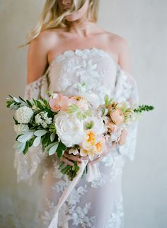 Hydrangea, orchid, peony, and ranunculus wedding bouquet: Photography: Jose Villa Photography - josevillaphoto.com Read More on SMP: http://www.stylemepretty.com/2016/10/12/ethereal-ranch-wedding-inspirationa/