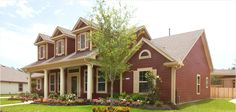 Brownish Red painted siding, with cream shudders. James Hardie - Design Ideas | Color Dashboard