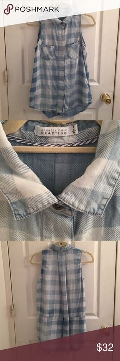 Kenneth Cole Reaction Shirt Kenneth Cole Reaction Shades Of Blue Plaid Shirt. Gently used once.Size Small. Sleeveless bra friendly. Collard. 2 front pockets. Silver tone hidden button down closure. Shirt tail hem which is split, not enough though to show anything & u don't need a tank underneath. Very soft & looks great with denim or white! Prettier in person not showing right on hanger. 100% Tencel. Machine wash. Tumble dry. NO TRADES. Kenneth Cole Reaction Tops Button Down Shirts