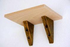 Simple shelf brackets:  http://img.ehowcdn.com/article-new/ehow/images/a04/ra/hn/build-shelf-brackets-800x800.jpg