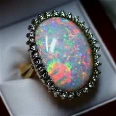 Opals are a magical stone and no other stone looks like them. The fire in an opal is truly amazing and setting an opal on a silver or gold ring...