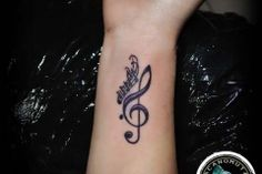 Tattoo notes is a perfect suggestion for your musician tattoo.