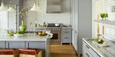 Bored with white kitchens, designer Angie Hranowsky tried a fresh take on neutral hues.