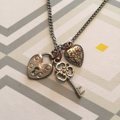 Lock and key necklace Metal lock and key necklace. Shows definite signs of wear as shown in the pictures. Clasp closure. Jewelry Necklaces