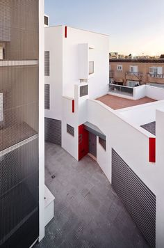 This social housing complex in Ibiza by Spanish office Castell-Pons Arquitectes features two jagged apartment blocks arranged around a central courtyard