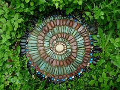 Round step stone with marbles, Indonesian Turquoise, Red Montana Rainbow, Black Mexican Beach and center beach stone - Another amazing piece of garden art by Mosaic Artist Jeffrey Bale from Portland, OR