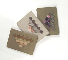 The perfect gift for the stylish traveler in your life: a scalloped leather passport holder. $58.00.
