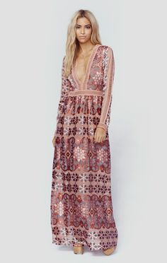 "The Juliet Maxi Dress by For Love and Lemons is a vision with the brand's signature floral print on a silk satin burnout, mini ladder cut-out trim, nude bodysuit lining with deep v neckline, and flowing body. Made in USADry Clean OnlyPoly BlendFit Guide:Model is 5ft 7 inches; Bust: 34"", Waist: 23"", Hips: 34""Model is wearing a size XSRelaxed FitShoes Featured Not Available For Purchase"