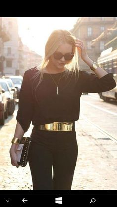 RANDY: jumpsuit black jumpsuit backless gold belt classy fashion vibe fashion classy and fabulous all black everything blonde hair ponytail necklace gold bracelet bag black and gold
