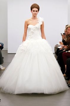 Vera Wang: Applique flowers are having a moment on the catwalk and the red carpet, and this one shoulder number incorporates the decoration delicately.