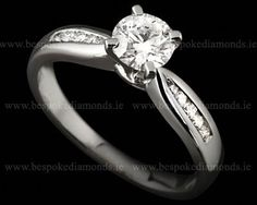 Engagement rings with round centre diamond and diamonds in band engagement-rings