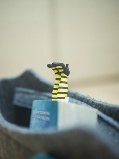 Louisa bookmark. Legs in yellow striped socks by MyBookmark