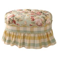 Button-tufted ottoman with a gathered skirt and wood frame.   Product: OttomanConstruction Material: Fabric and w...