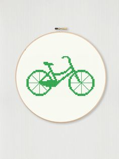 This counted cross stitch pattern allows you to create your own embroidered retro bicycle with your choice of fabric and thread color. The